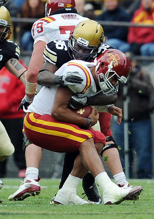 "Austen Arnaud, of Iowa State, is sacked by Chiera Uzo-Diribe of CU.<br /> For more photos of the game, go to  <a href=""http://www.dailycamera.com"">http://www.dailycamera.com</a><br /> Cliff Grassmick / November 13, 2010"