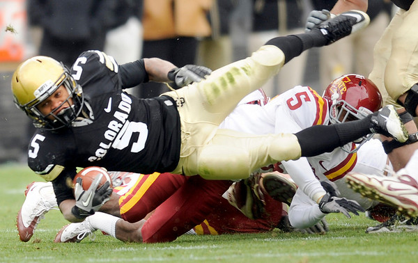 """University of Colorado tailback Rodney Stewart tries to gain extra yardage after rushing the ball on Saturday, Nov. 13, during a football game against Iowa State at Folsom Field. CU defeated Iowa 34-14.<br /> For more photos go to  <a href=""""http://www.dailycamera.com"""">http://www.dailycamera.com</a><br /> Photo by Jeremy Papasso"""