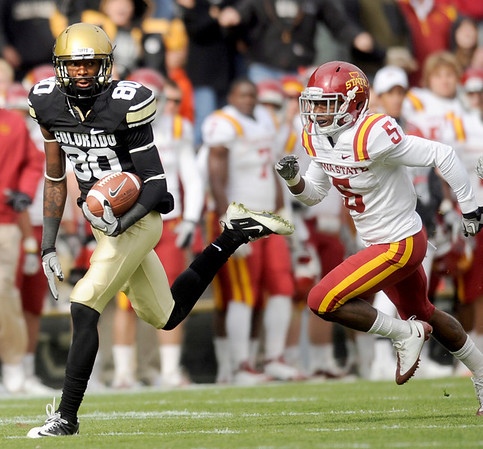 "University of Colorado receiver Paul Richardson flies past Iowa defender Jeremy Reeves on Saturday, Nov. 13, during a football game against Iowa State at Folsom Field. CU defeated Iowa 34-14.<br /> For more photos go to  <a href=""http://www.dailycamera.com"">http://www.dailycamera.com</a><br /> Photo by Jeremy Papasso"