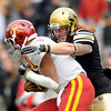 "University of Colorado linebacker B.J. Beatty sacks Iowa quarterback Austen Arnaud on Saturday, Nov. 13, during a football game against Iowa State at Folsom Field. CU defeated Iowa 34-14.<br /> For more photos go to  <a href=""http://www.dailycamera.com"">http://www.dailycamera.com</a><br /> Photo by Jeremy Papasso"