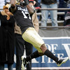 "University of Colorado receiver Toney Clemons makes a touchdown catch in the second quarter of the football game on Saturday, Nov. 13,  against Iowa State at Folsom Field. CU defeated Iowa 34-14.<br /> For more photos go to  <a href=""http://www.dailycamera.com"">http://www.dailycamera.com</a><br /> Photo by Jeremy Papasso"
