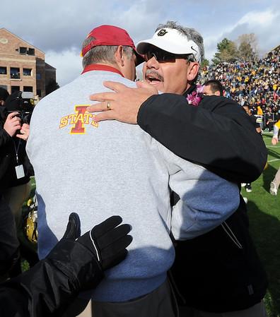 """Interim coach, Brian Cabral, right, hugs ISU coach Paul Rhoads.<br /> For more photos of the game, go to  <a href=""""http://www.dailycamera.com"""">http://www.dailycamera.com</a><br /> Cliff Grassmick / November 13, 2010"""