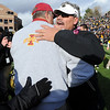 "Interim coach, Brian Cabral, right, hugs ISU coach Paul Rhoads.<br /> For more photos of the game, go to  <a href=""http://www.dailycamera.com"">http://www.dailycamera.com</a><br /> Cliff Grassmick / November 13, 2010"
