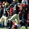 """Michael Sipili of CU takes an Austen Arnaud fumble in for a score against Iowa State.<br /> For more photos of the game, go to  <a href=""""http://www.dailycamera.com"""">http://www.dailycamera.com</a><br /> Cliff Grassmick / November 13, 2010"""