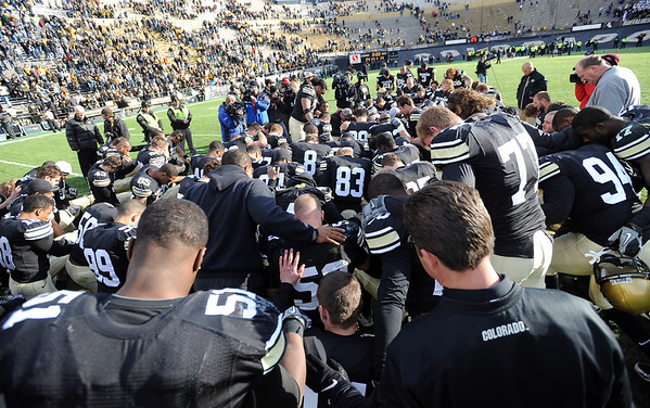 """The CU football team prays after the Iowa State win.<br /> For more photos of the game, go to  <a href=""""http://www.dailycamera.com"""">http://www.dailycamera.com</a><br /> Cliff Grassmick / November 13, 2010"""