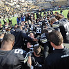 "The CU football team prays after the Iowa State win.<br /> For more photos of the game, go to  <a href=""http://www.dailycamera.com"">http://www.dailycamera.com</a><br /> Cliff Grassmick / November 13, 2010"
