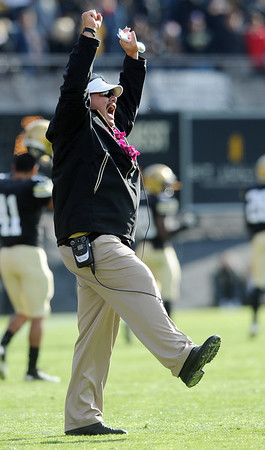 "Interim coach Brian Cabral celebrates a CU score against Iowa State.<br /> For more photos of the game, go to  <a href=""http://www.dailycamera.com"">http://www.dailycamera.com</a><br /> Cliff Grassmick / November 13, 2010"