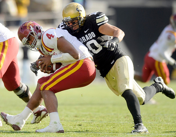 """University of Colorado linebacker Michael Sipili sacks Iowa State quarterback Austen Arnaud on Saturday, Nov. 13, during a football game against Iowa State at Folsom Field. CU defeated Iowa 34-14.<br /> For more photos go to  <a href=""""http://www.dailycamera.com"""">http://www.dailycamera.com</a><br /> Photo by Jeremy Papasso"""