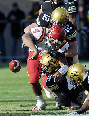 """Patrick Mahnke (12) and Nick Kasa, both of CU, sack Austen Arnaud of ISU. The fumble was taken in for a score by Michael Sipili.<br /> For more photos of the game, go to  <a href=""""http://www.dailycamera.com"""">http://www.dailycamera.com</a><br /> Cliff Grassmick / November 13, 2010"""