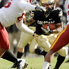 "University of Colorado tailback Rodney Stewart rushes the ball before being taken down by Iowa lineman Bailey Johnson, left, on Saturday, Nov. 13, during a football game against Iowa State at Folsom Field. CU defeated Iowa 34-14.<br /> For more photos go to  <a href=""http://www.dailycamera.com"">http://www.dailycamera.com</a><br /> Photo by Jeremy Papasso"