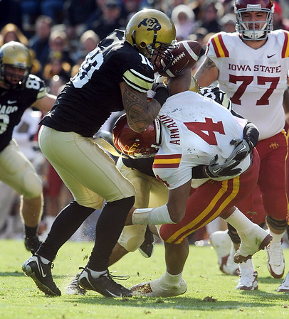"""Austen Arnaud of ISU, is sacked by Michael Sipili. He lost the ball but it wasn't ruled a fumble.<br /> For more photos of the game, go to  <a href=""""http://www.dailycamera.com"""">http://www.dailycamera.com</a><br /> Cliff Grassmick / November 13, 2010"""