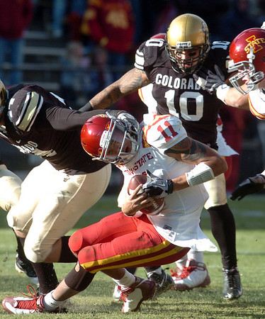 "Jerome Tiller, of Iowa State, is sacked by Nick Kasa, right, and Michael Sipili of CU.<br /> For more photos of the game, go to  <a href=""http://www.dailycamera.com"">http://www.dailycamera.com</a><br /> Cliff Grassmick / November 13, 2010"