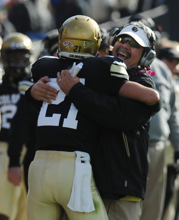 """Brian Cabral hugs Scotty McKnight after Scotty's TD catch.<br /> For more photos of the game, go to  <a href=""""http://www.dailycamera.com"""">http://www.dailycamera.com</a><br /> Cliff Grassmick / November 13, 2010"""