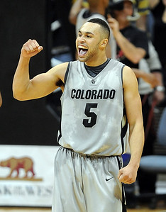 Marcus Relphorde of Colorado celebrates the win over Iowa State. For more  photos of the game, go to www.dailycamera.com. Cliff Grassmick / February 27, 2010