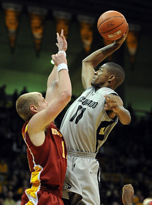 Cory Higgins of CU slams one over Scott Christopherson of Iowa State on Saturday. For more  photos of the game, go to www.dailycamera.com. Cliff Grassmick / February 27, 2010