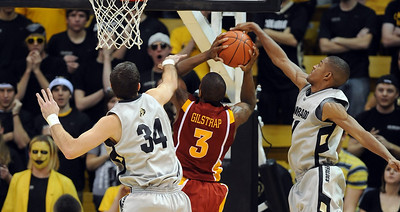 Marquis Gilstrap of ISU gets his shot blocked by Cory Higgins of CU. For more  photos of the game, go to www.dailycamera.com. Cliff Grassmick / February 27, 2010