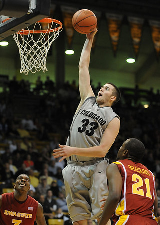 "Austin Dufault of CU goes up to dunk in the iowa State game on Saturday.<br /> For more  photos of the game, go to  <a href=""http://www.dailycamera.com"">http://www.dailycamera.com</a>.<br /> Cliff Grassmick / February 27, 2010"