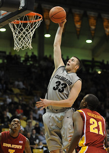 Austin Dufault of CU goes up to dunk in the iowa State game on Saturday. For more  photos of the game, go to www.dailycamera.com. Cliff Grassmick / February 27, 2010