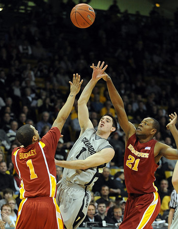 "Nate Tomlinson of CU throws up a floater against Iowa State.<br /> For more  photos of the game, go to  <a href=""http://www.dailycamera.com"">http://www.dailycamera.com</a>.<br /> Cliff Grassmick / February 27, 2010"