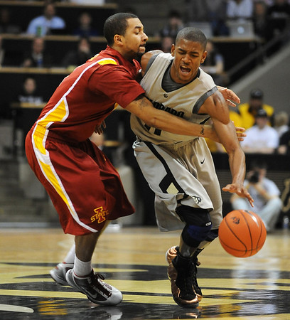 "Cory Higgins of CU gets fouled by Diante Garrett of ISU.<br /> For more  photos of the game, go to  <a href=""http://www.dailycamera.com"">http://www.dailycamera.com</a>.<br /> Cliff Grassmick / February 27, 2010"