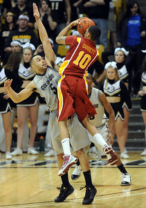 Diante Garrett of Iowa State takes the last shot over Marcus Relphored, he missed and the Buffs won 75-72. For more  photos of the game, go to www.dailycamera.com. Cliff Grassmick / February 27, 2010
