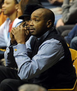 Rod Higgins, a former NBA player and current executive, watches his son Cory play ISU in Boulder on Saturday. For more  photos of the game, go to www.dailycamera.com. Cliff Grassmick / February 27, 2010