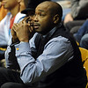 "Rod Higgins, a former NBA player and current executive, watches his son Cory play ISU in Boulder on Saturday.<br /> For more  photos of the game, go to  <a href=""http://www.dailycamera.com"">http://www.dailycamera.com</a>.<br /> Cliff Grassmick / February 27, 2010"