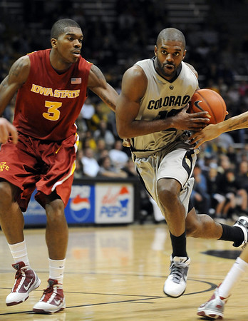 "Dwight Thorne of CU drives past Marquis Gilstrap of Iowa State.<br /> For more  photos of the game, go to  <a href=""http://www.dailycamera.com"">http://www.dailycamera.com</a>.<br /> Cliff Grassmick / February 27, 2010"