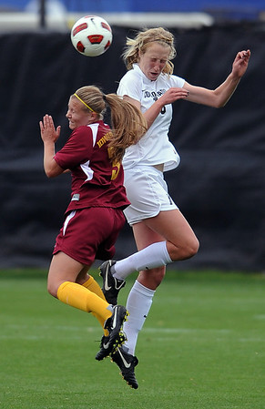 """Susie Potterveld, left, of Iowa State, and Lizzy Herzl of CU, meet at the ball on a header on Sunday.<br /> For more photos of the game, go to  <a href=""""http://www.dailycamera.com"""">http://www.dailycamera.com</a>.<br /> Cliff Grassmick / October 10, 2010"""