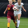 "Theresa Kucera, left, of ISU, and Kelly Ross of CU, run down a ball in the game on Sunday.<br /> For more photos of the game, go to  <a href=""http://www.dailycamera.com"">http://www.dailycamera.com</a>.<br /> Cliff Grassmick / October 10, 2010"