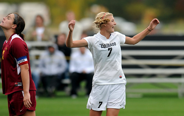 "Shaye Marshall, right, of CU,  reacts to her goal against Iowa State, as does Mary Kate McLaughlin of ISU.<br /> For more photos of the game, go to  <a href=""http://www.dailycamera.com"">http://www.dailycamera.com</a>.<br /> Cliff Grassmick / October 10, 2010"
