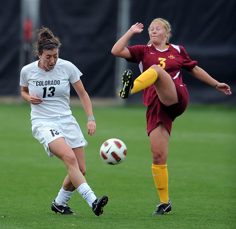 "Kate Russell, left, of CU, and Susie Potterveld,  of ISU, kick at the ball on Sunday.<br /> For more photos of the game, go to  <a href=""http://www.dailycamera.com"">http://www.dailycamera.com</a>.<br /> Cliff Grassmick / October 10, 2010"