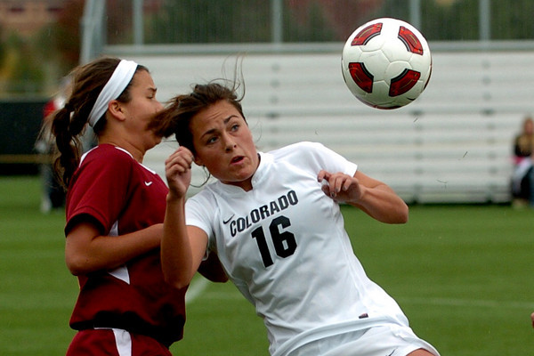 """Amanda Foulk (16) of CU, moves Meredith Skitt, of ISU, away from the ball.<br /> For more photos of the game, go to  <a href=""""http://www.dailycamera.com"""">http://www.dailycamera.com</a>.<br /> Cliff Grassmick / October 10, 2010"""