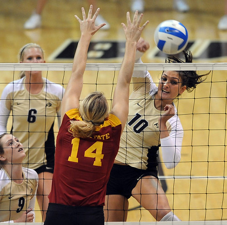 """Anicia Santos (10) of CU hits over  Jamie Straube  of ISU.<br /> For more photos of the game, go to  <a href=""""http://www.dailycamera.com"""">http://www.dailycamera.com</a><br /> Cliff Grassmick / October 20, 2010"""
