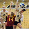 "Anicia Santos (10) of CU hits over  Jamie Straube  of ISU.<br /> For more photos of the game, go to  <a href=""http://www.dailycamera.com"">http://www.dailycamera.com</a><br /> Cliff Grassmick / October 20, 2010"