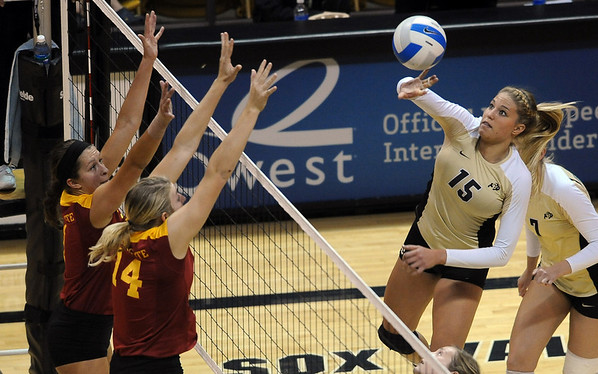 """Nikki Lindow of CU tries to hit past the Iowa State defenders.<br /> For more photos of the game, go to  <a href=""""http://www.dailycamera.com"""">http://www.dailycamera.com</a><br /> Cliff Grassmick / October 20, 2010"""