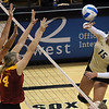 "Nikki Lindow of CU tries to hit past the Iowa State defenders.<br /> For more photos of the game, go to  <a href=""http://www.dailycamera.com"">http://www.dailycamera.com</a><br /> Cliff Grassmick / October 20, 2010"