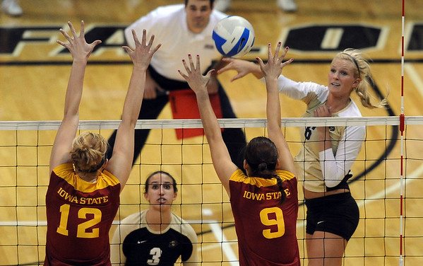 "Kerra Schroeder of CU, hits past Debbie Stadick (12) and Alison Landwehr, both of ISU.<br /> For more photos of the game, go to  <a href=""http://www.dailycamera.com"">http://www.dailycamera.com</a><br /> Cliff Grassmick / October 20, 2010"