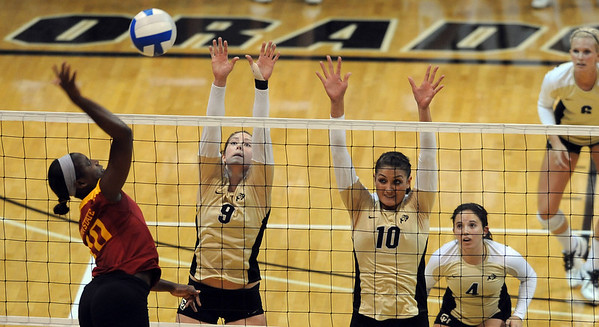 "Victoria Henson of ISU, hits against Alyssa Valentine and Anicia Santos, both of CU.<br /> For more photos of the game, go to  <a href=""http://www.dailycamera.com"">http://www.dailycamera.com</a><br /> Cliff Grassmick / October 20, 2010"