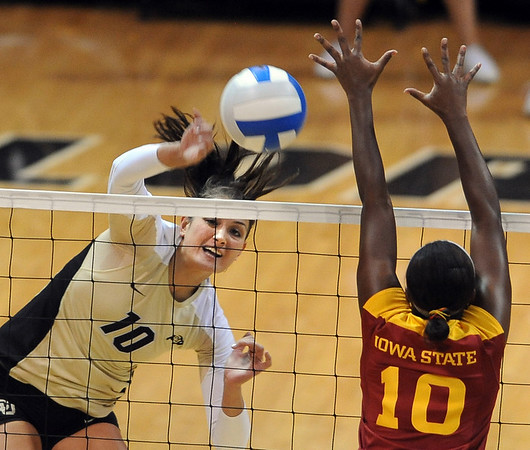 """Anicia Santos of CU hits over Victoria Henson of ISU.<br /> For more photos of the game, go to  <a href=""""http://www.dailycamera.com"""">http://www.dailycamera.com</a><br /> Cliff Grassmick / October 20, 2010"""