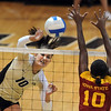 "Anicia Santos of CU hits over Victoria Henson of ISU.<br /> For more photos of the game, go to  <a href=""http://www.dailycamera.com"">http://www.dailycamera.com</a><br /> Cliff Grassmick / October 20, 2010"