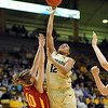 """Ashley Wilson of CU puts a shot over Lauren Mansfield of Iowa State.<br /> For more photos of the game, go to  <a href=""""http://www.dailycamera.com"""">http://www.dailycamera.com</a>.<br /> Cliff Grassmick / January 15, 2011"""