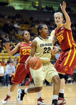 "Brittany Spears of Colorado looks for room around Chassidy Cole (23) and Anna Prins of Iowa State.<br /> For more photos of the game, go to  <a href=""http://www.dailycamera.com"">http://www.dailycamera.com</a>.<br /> Cliff Grassmick / January 15, 2011"
