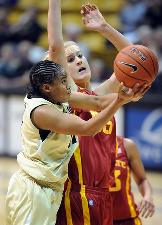 """Brttany Wilson of CU tries to score past Anna Prins of ISU.<br /> For more photos of the game, go to  <a href=""""http://www.dailycamera.com"""">http://www.dailycamera.com</a>.<br /> Cliff Grassmick / January 15, 2011"""