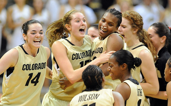 """Meagan Malcolm-Peck (14), Julie Seabrook (15) and Brittany Spears celebrate the overtime win with other CU teammates over Iowa State.<br /> For more photos of the game, go to  <a href=""""http://www.dailycamera.com"""">http://www.dailycamera.com</a>.<br /> Cliff Grassmick / January 15, 2011"""
