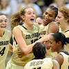 "Meagan Malcolm-Peck (14), Julie Seabrook (15) and Brittany Spears celebrate the overtime win with other CU teammates over Iowa State.<br /> For more photos of the game, go to  <a href=""http://www.dailycamera.com"">http://www.dailycamera.com</a>.<br /> Cliff Grassmick / January 15, 2011"