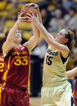 """Chelsea Poppens, left, of ISU, and Julie Seabrook of CU, get the same rebound.<br /> For more photos of the game, go to  <a href=""""http://www.dailycamera.com"""">http://www.dailycamera.com</a>.<br /> Cliff Grassmick / January 15, 2011"""