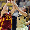 "Chelsea Poppens, left, of ISU, and Julie Seabrook of CU, get the same rebound.<br /> For more photos of the game, go to  <a href=""http://www.dailycamera.com"">http://www.dailycamera.com</a>.<br /> Cliff Grassmick / January 15, 2011"