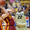 "Brittany Spears of Colorado, pressure the shot of Chelsea Poppens of ISU.<br /> For more photos of the game, go to  <a href=""http://www.dailycamera.com"">http://www.dailycamera.com</a>.<br /> Cliff Grassmick / January 15, 2011"