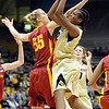 """Brittany Spears of Colorado shoots past Anna Prins of Iowa State. Prins played at Broomfield High School.<br /> For more photos of the game, go to  <a href=""""http://www.dailycamera.com"""">http://www.dailycamera.com</a>.<br /> Cliff Grassmick / January 15, 2011"""